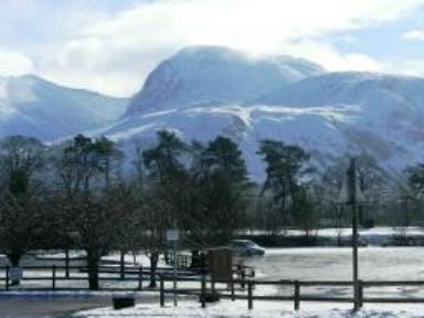 Ben Nevis in the snow as seen from Chase The Wild Goose Hostel Banavie Fort William